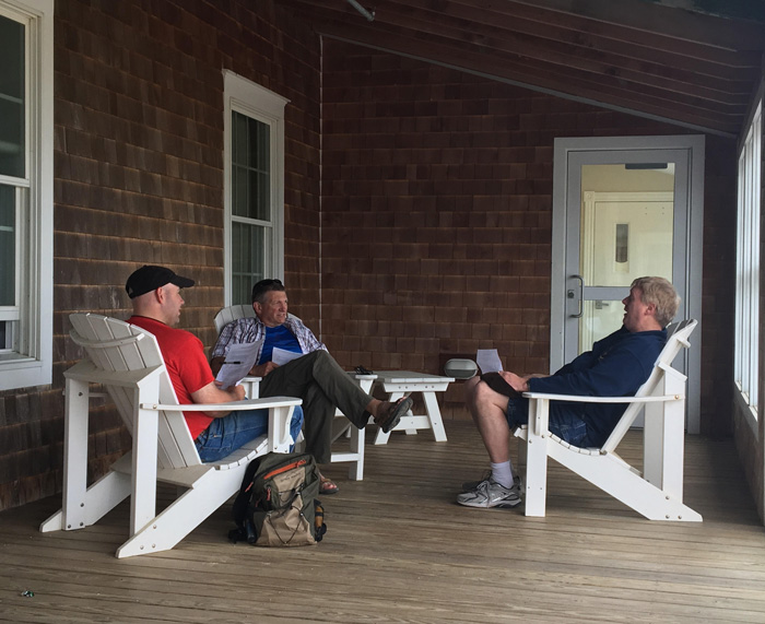 Men talking on a porch